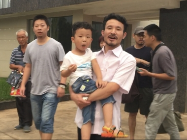 Chinese labour activist Hua Haifend leaves the police station after being released. AP