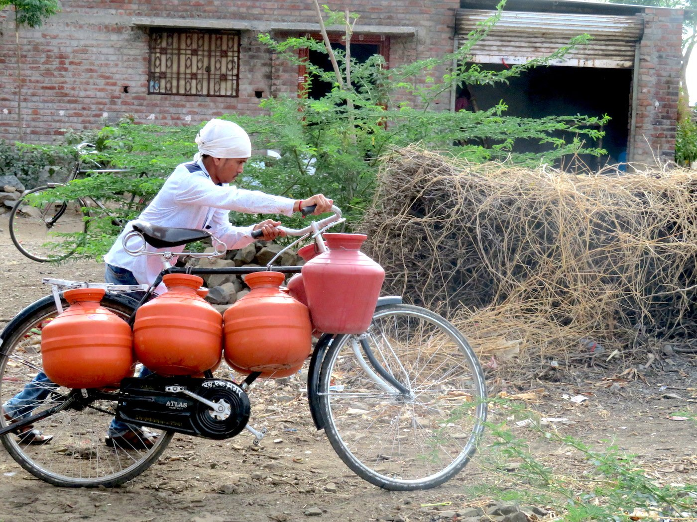 People must travel long distances to collect water as the crisis deepens across the Marathwada region of Maharashtra. Parth MN
