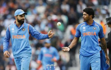 India's captain Virat Kohli, left, speaks to Umesh Yadav during the match against Sri Lanka. AP Photo
