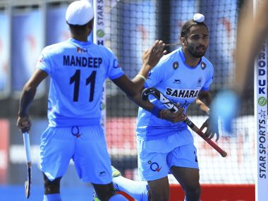 India's Akashdeep Singh, right, celebrates scoring his side's first goal of the game against the Netherlands during the Men's World Hockey League match at Lee Valley Hockey Centre, London Tuesday June 20, 2017. (Nigel French/PA via AP)
