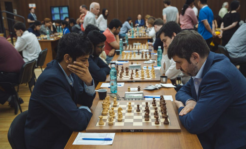 Playing against the mighty Russians. Image courtesy: FIDE