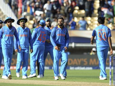 The Indian team celebrates a wicket at the Champions Trophy. AP