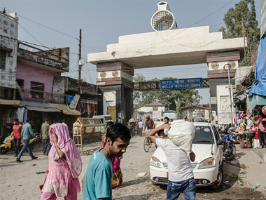 Pedestrians and cyclists cross the border between India and Nepal in Sunauli. Getty Images