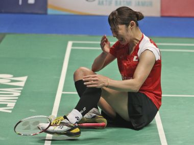 Sayaka Sato reacts after defeating Sung Ji-hyun during their women's singles final. AP