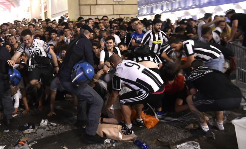 Juventus' fans flee from Turin's San Carlo Square following panic created by the explosion of firecrackers on Saturday. REUTERS