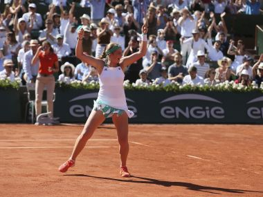 Jelena Ostapenko jumps as she defeats Simona Halep in their final match of the French Open. AP