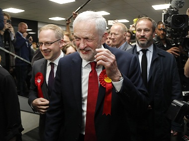 Jeremy Corbyn smiles after arriving for the declaration at his constituency in London. AP