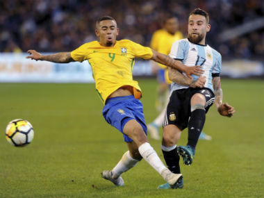 Gabriel Jesus and Nicolas Otamendi in action during the friendly game between Argentina and Brazil. AP