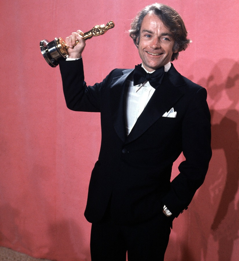 "FILE - In this March 28, 1977, file photo, John C. Avildsen shows off the Oscar he won for best director for ""Rocky,"" at the Academy Awards in Los Angeles. Avildsen, who directed ""Rocky"" and ""The Karate Kid,"" the hugely successful underdog fables that went on to become Hollywood franchises, has died at age 81. Avildsen's son Anthony says his father died Friday, June 16, 2017, in Los Angeles from pancreatic cancer. (AP Photo. File)"