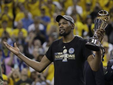 Golden State Warriors forward Kevin Durant gestures as he holds the Bill Russell NBA Finals MVP Award. AP Photo