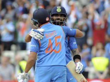 Virat Kohli and Rohit Sharma celebrate at the end of the ICC Champions Trophy semifinal match between Bangladesh and India at Edgbaston in Birmingham, England, Thursday, June 15, 2017. (AP Photo/Rui Vieira)