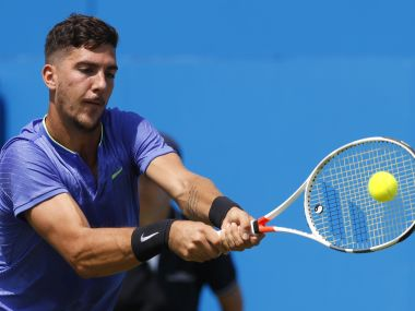 Thanasi Kokkinakis of Australia plays a return to Milos Raonic of Canada during day two of the Queen's Club tennis tournament in London, Tuesday, June 20, 2017. (AP Photo/Kirsty Wigglesworth)