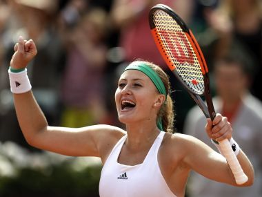 Kristina Mladenovic celebrates her win over Garbine Muguruza during their fourth round match. AP