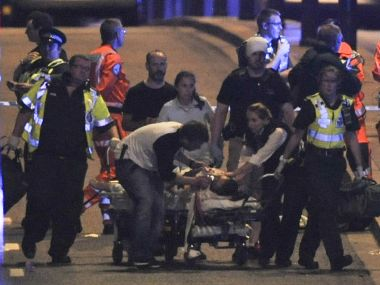 Police and members of the emergency services attend to victims of a terror attack on London Bridge on Saturday. AFP