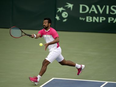 File image of Indian tennis player Leander Paes plays a shot during a training session at the Balewadi Sports Complex in Pune on February 2, 2017. The three-day David Cup Tennis . AFP PHOTO