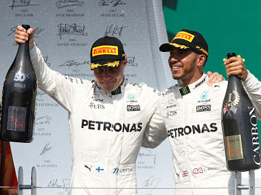 Mercedes' Lewis Hamilton celebrates winning Canadian Grand Prixte with Valtteri Bottas. Reuters