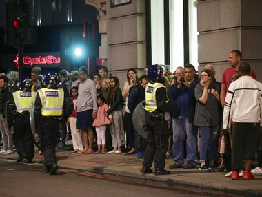 Guests from the Premier Inn Bankside Hotel are evacuated  on the day of attack in London. AP
