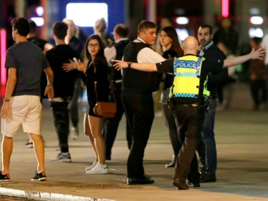 A police officer clears people away from the area near London Bridge after an incident in central London on Saturday. AP