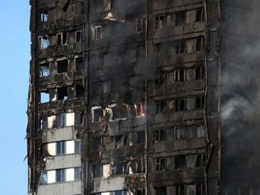 The burnt facade of a tower block is seen as firefighters tackle a serious fire at Latimer Road in West London. Reuters