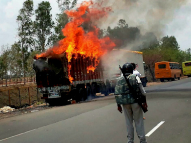 Farmers torch vehicles during a protest in Phanda near Bhopal on Friday. PTI