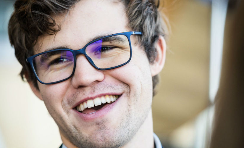 Ninth place in a super tournament is not a normal result for Magnus Carlsen, but he kept himself in good spirits. Image courtesy: Lennart Ootes