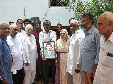 AIKS members with the bereaved family members in Mandsaur. Firstpost/Debobrat Ghose