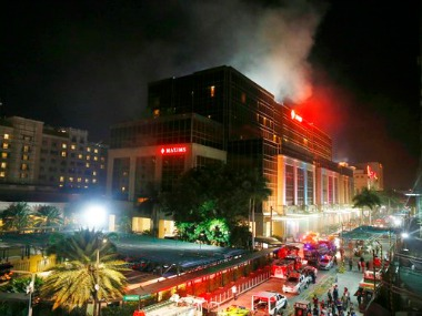 Smoke rising from the Resorts World Manila complex, Philippines. AP
