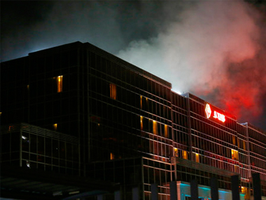 Smoke rises from the Resorts World Manila complex early Friday where a gunman shot 37 people dead. AP