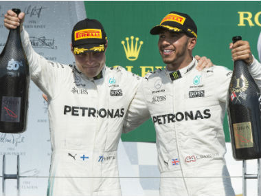 Canadian Grand Prix winner Mercedes driver Lewis Hamilton, right, of Britain, celebrates with teammate and second-place finisher Valtteri Bottas (77), of Finland, during victory ceremonies of the Formula One Canadian Grand Prix in Montreal on Sunday, June 11, 2017. (Paul Chiasson/The Canadian Press via AP)