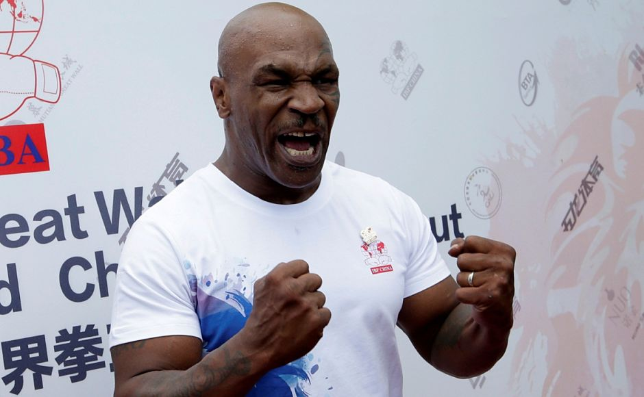 Former boxer Mike Tyson reacts as he speaks to the media, before the weigh-in of International Boxing Federation (IBF) World Championship Bout at the Mutianyu section of the Great Wall of China, on the outskirts of Beijing, China, May 24, 2016. REUTERS/Jason Lee - RTSFOB8