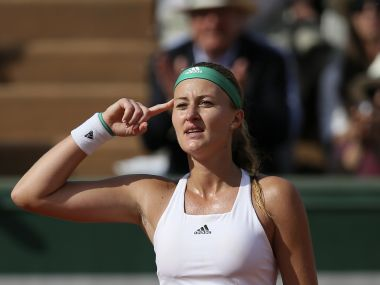 France's Kristina Mladenovic gestures as she defeats Italy's Sara Errani after their second round match of the French Open tennis tournament at the Roland Garros stadium, Wednesday, May 31, 2017 in Paris. Mladenovic won 6-2, 6-3. (AP Photo/David Vincent)