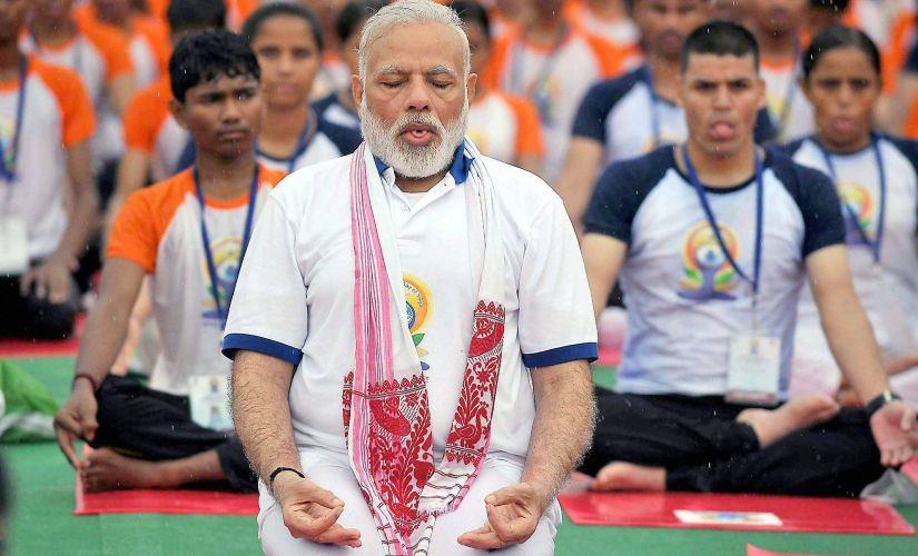 Yoga connecting world, says Modi as millions stretch and bend