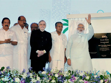 Prime Minister Narendra Modi dedicates the Kochi Metro to the nation as Kerala Governor P Sathasivam, CM Pinarayi Vijayan and Union Minister Venkaiah Naidu looks on, in Kerala on Saturday. PTI