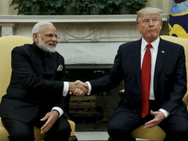 Narendra Modi and Donald Trump. PTI