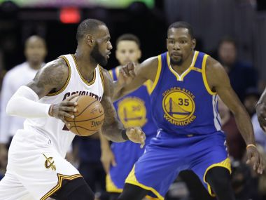 LeBron James drives on Kevin Durant during Game 4 of the NBA Finals. AP
