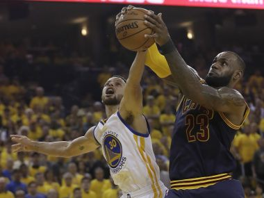 LeBron James (23) grabs a rebound against Stephen Curry (30) during Game 1 of NBA Finals. AP