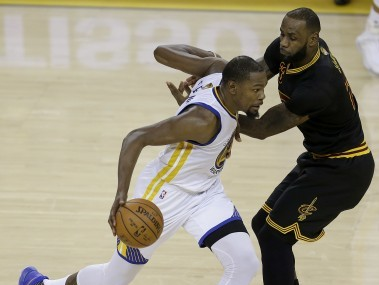 Kevin Durant, left, drives on LeBron James during Game 2 of NBA Finals. AP