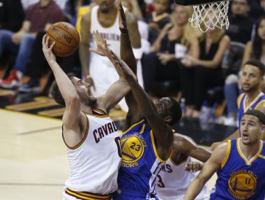 Cleveland Cavaliers' Kevin Love shoots over Golden State Warriors' Draymond Green during Game 4 of the NBA Finals. AP