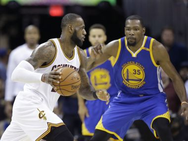 Cleveland Cavaliers LeBron James drives on Golden State Warriors forward Kevin Durant during Game 4. AP