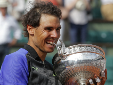 Rafael Nadal celebrates with the trophy after his victory over Stan Wawrinka at Roland Garros.