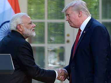 Indian prime minister Narendra Modi shakes hands with US president Donald Trump. AP