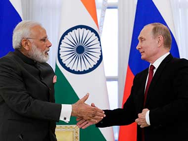 India's Prime Minister Narendra Modi and Russian President Vladimir Putin shake hands after a signing ceremony at the St. Petersburg International Economic Forum in St. Petersburg, Russia. AP
