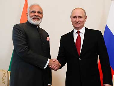 Russian President Vladimir Putin shakes hands with India's Prime Minister Narendra Modi prior their talks at the St. Petersburg International Economic Forum in St. Petersburg, Russia. AP