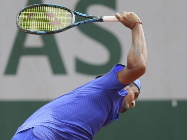 Australia's Nick Kyrgios breaks his racket in his second round match against South Africa's Kevin Anderson at the French Open tennis tournament at the Roland Garros stadium, in Paris, France. Thursday, June 1, 2017. (AP Photo/David Vincent)