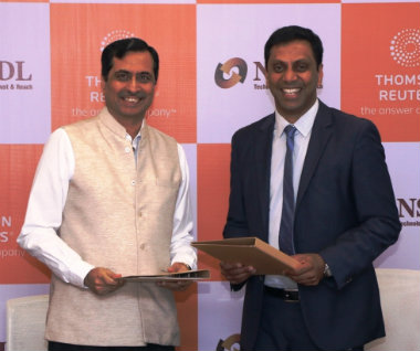 Gagan Rai, MD and CEO, NSDL e-Gov (left) with Pradeep Lankapalli, Managing Director, Thomson Reuters South Asia