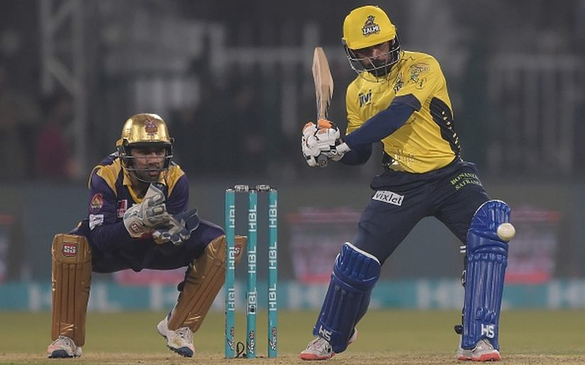 Mohammad Hafeez (R) of Peshawar Zalmi plays a shot as Quetta Gladiators captain and wicketkeeper Sarfraz Ahmed looks on during the final of the Pakistan Super League. Getty