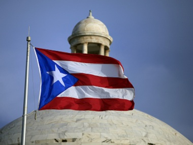The Puerto Rican flag flies in front of the Capitol in San Juan. AP file image