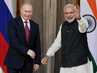 File image of Valdimir Putin and Narendra Modi. PTI