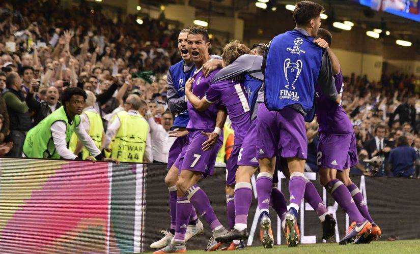 Real Madrid's Cristiano Ronaldo (2nd from left) is surrounded by teammates after he scored their third goal on Saturday. AFP