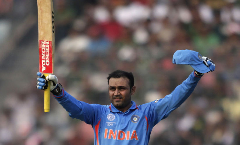 India's Virender Sehwag celebrates scoring his century during the World Cup match against Bangladesh in Dhaka. Reuters.